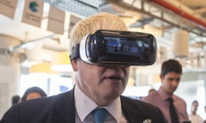 Boris Johnson tries on virtual reality goggles on a visit to Google's offices in Tel Aviv