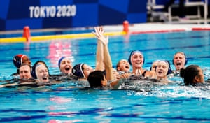 US players celebrate winning the women's gold medal final against Spain.