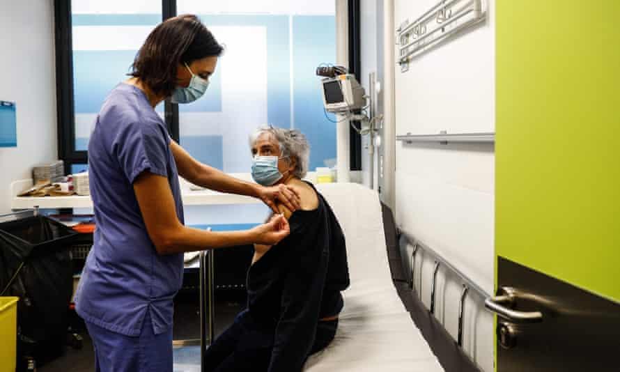 A patient receives a Covid vaccine at the Hôtel-Dieu hospital in Paris