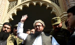 Hafiz Saeed waves to supporters as he leaves court in Lahore