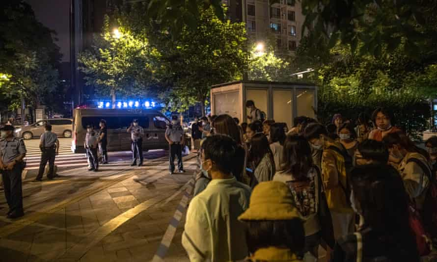 Supporters of Xianzi gather outside court during a hearing on her sexual harassment case in Beijing.