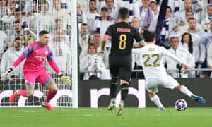 Isco of Real Madrid scores the opening goal.