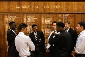 Students wait in line to get their picture taken at the beginning of the school year at the boarding school Hilton College in South Africa