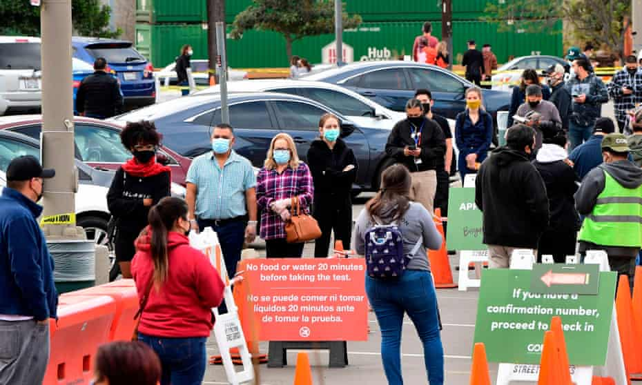 People wait in line at a Covid-19 testing center in Los Angeles this month.
