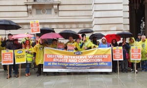 Workers on strike outside the Foreign Office in London