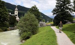 Conor walking past St Sebastian's church in Ramsau