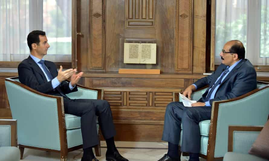 Bashar al-Assad (left) answering questions from al-Manar's Amro Nassef during an interview in Damascus. Assad expressed 'strong confidence' that Russia will continue supporting his embattled regime.