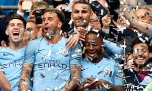 Manchester City celebrate winning last season's FA Cup following their capture of the Premier League title and the League Cup.