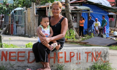 Grandmother with grandchild in the fishing village of San Dionisio devastated by typhoon Haiyan/Yolanda