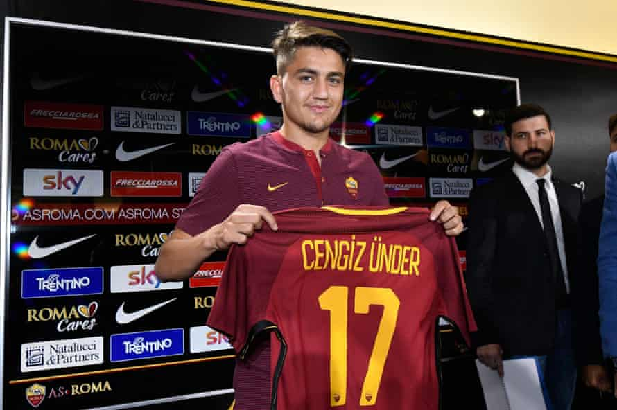 AS Roma's new player Cengiz Under poses with his new jersey