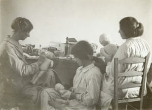 Three women working in a toy factory in Bow in 1914