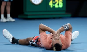 Nick Kyrgios celebrates victory after four hours and 26 minutes.