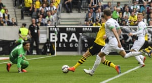 Marco Reus, centre, slots the ball past Mönchengladbach keeper Yann Sommerscores his Dortmund's second goal .