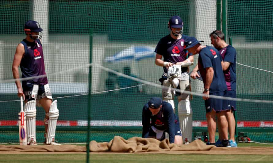 England players inspect the pitch during a practice session in Ahmedabad.