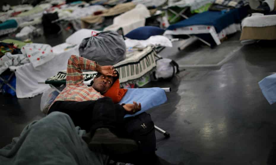 Evacuees of the powerful storm are taking shelter across the city, including here at the George R Brown Convention Center in downtown Houston.