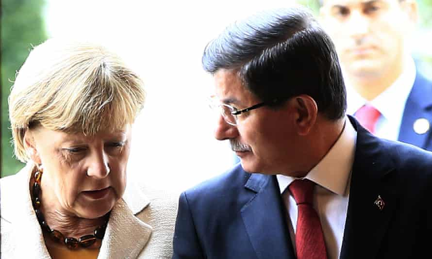 The German chancellor, Angela Merkel, with the Turkish prime minister, Ahmet Davutoğlu, in Istanbul on Sunday.