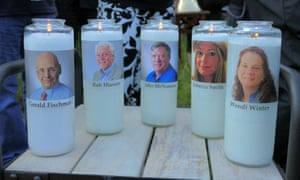 Candles honour the journalists killed at the Capital Gazette in Annapolis, including Wendi Winters, far right.