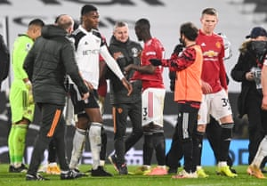 Manchester United manager Ole Gunnar Solskjaer looks pleased with the result as he congratulates his players after the final whistle.