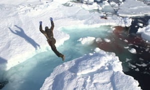 Northern exposure: a seal hunter leaps on to the ice to retrieve a carcass.