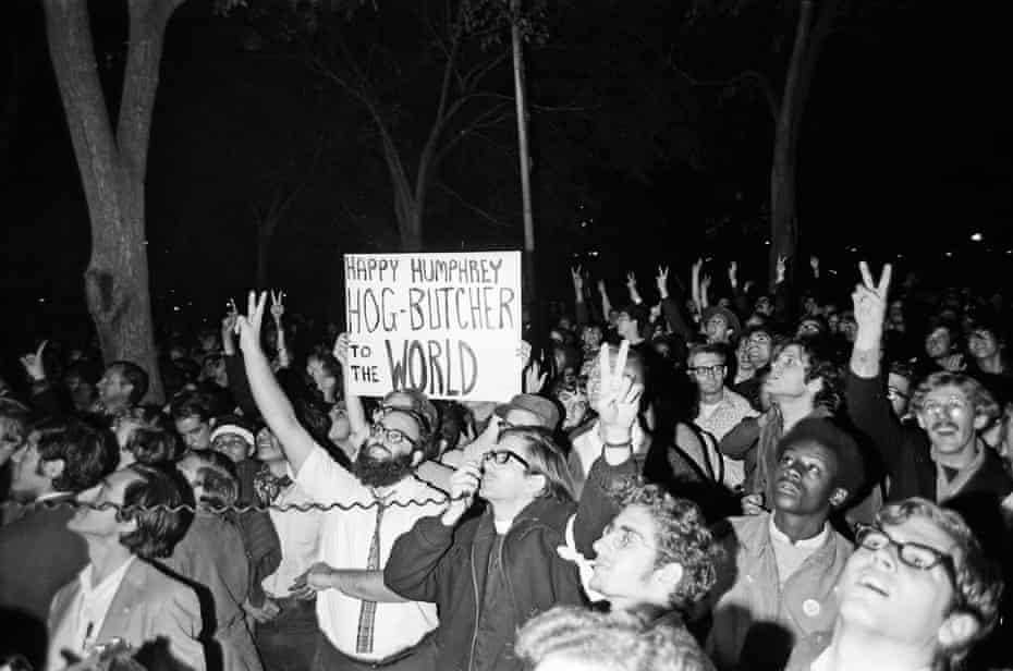 Demonstrators across the street from the Conrad Hilton hotel.