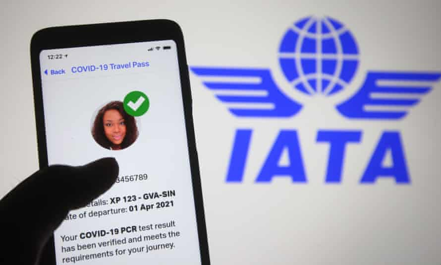 mobile phone displaying the IATA's Covid app in front of its logo