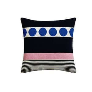 Cushion with an abstract pattern of navy, pink and white stripes and bold blue dots