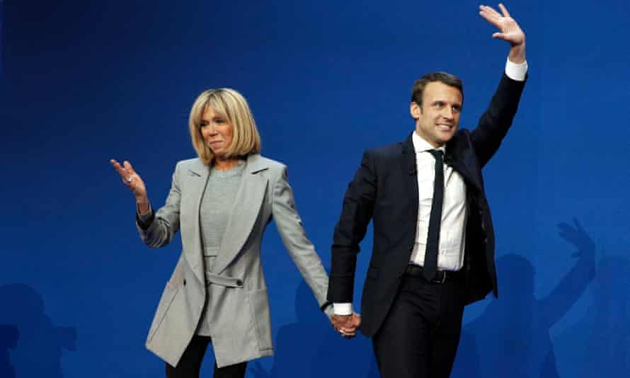Emmanuel Macron celebrates with wife, Brigitte Trogneux, after the first round