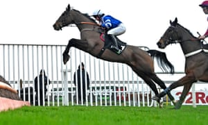 Frodon jumps the final fence in front of Keeper Hill on his way to winning the Silviniaco Conti Stakes at Kempton