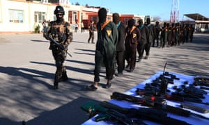 Afghan forces with suspects