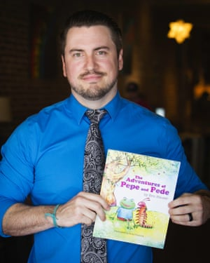 Eric Hauser with his book The Adventures of Pepe and Pede.