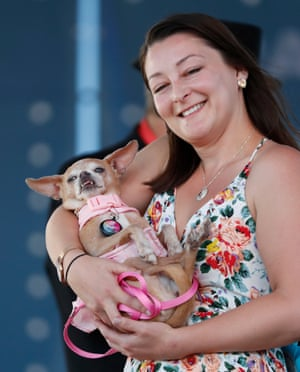 Whitney Sherman from Los Angeles, California, and her dog, Daisy, a 14-year -ld Chihuahua mix, on stage