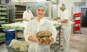 Roz Bado, head baker at Gail's Bakery, with loaves of Waste Bread.