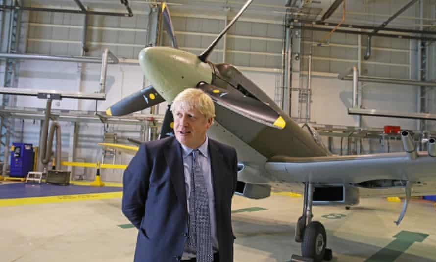 Boris Johnson alongside a Spitfire at RAF Lossiemouth, north-east Scotland