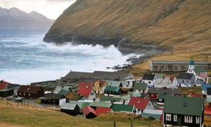 Gjogv in the Faroe Islands, bay and bare hills with waves crashing