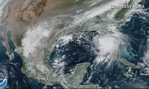 A satellite image of Hurricane Sally as a tropical storm in the Gulf of Mexico.