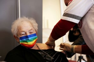 An elderly woman receives a booster shot of her vaccination against Covid-19 at an assisted living facility, in Netanya, Israel, on 19 January, 2021.