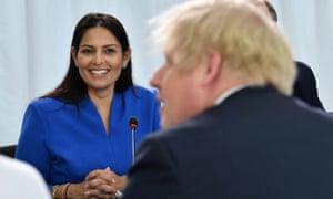Priti Patel and Boris Johnson at a cabinet meeting in Sunderland in January