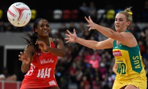 Sasha Corbin, wing attack for England, gets the ball away under pressure from the Diamonds' Gabrielle Simpson at Copper Box Arena in London in January.