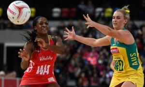 England's Sasha Corbin gets the ball away under a challenge from Gabrielle Simpson of Australia.