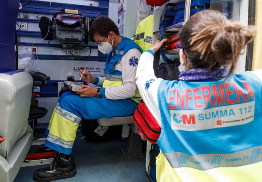 Marta, UVI6 nurse with Mateo who is finishing a report inside the ambulance.
