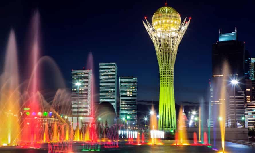 Song Fountain and Bayterek Tower illuminations along Astana's central boulevard.