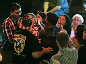Campaign workers and supporters physically remove protesters from a campaign rally for a Florida candidate endorsed by Donald Trump.