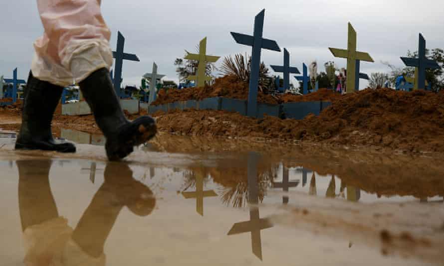 A gravedigger walks at the Parque Taruma cemetery, amid the coronavirus disease outbreak, in Manaus, Amazonas state, on Thursday.
