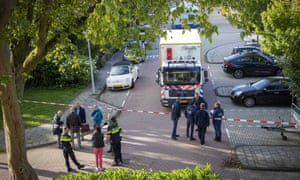 Police at the scene in the Buitenveldert suburb of Amsterdam after the lawyer Derk Wiersum was shot dead