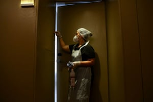 Cleaning staff at the NH Collection Hotel in Porto get ready for football fans.