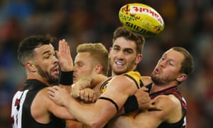 Anthony Miles of the Tigers is tackled by Ryan Crowley of the Bombers (L) and James Kelly during the Dreamtime at the 'G clash at the MCG.