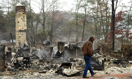 Local resident Ralph Cogdill checks the debris of his house which was ruined by a wildfire in Pigeon Forge, Tennessee on Nov. 30, 2016.