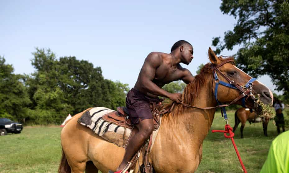 Dee Davis checks out his hourse at the trail ride.