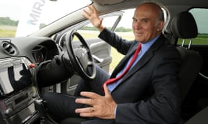 Vince Cable sits in a driverless car