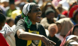 At the 50th anniversary of the original march, a woman is seen wearing an ANC T-shirt in Pretoria, South Africa.